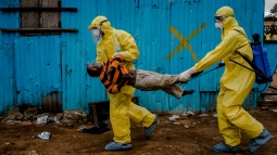 Medical staff carry James Dorbor, 8, suspected of having Ebola, into a treatment facility in Monrovia, Liberia, September 5, 2014. Daniel Berehulak was awarded the Pulitzer Prize for feature photography on April 20, 2015, for his coverage of the Ebola outbreak in West Africa for The New York Times. Picture taken September 5, 2014. REUTERS/Daniel Berehulak/The New York Times/Handout via Reuters ATTENTION EDITORS - NO SALES. NO ARCHIVES. FOR EDITORIAL USE ONLY. NOT FOR SALE FOR MARKETING OR ADVERTISING CAMPAIGNS. THIS IMAGE HAS BEEN SUPPLIED BY A THIRD PARTY. IT IS DISTRIBUTED, EXACTLY AS RECEIVED BY REUTERS, AS A SERVICE TO CLIENTS. NO COMMERCIAL USE. TPX IMAGES OF THE DAY